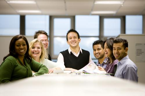 a photo of a group of adult learners around a table